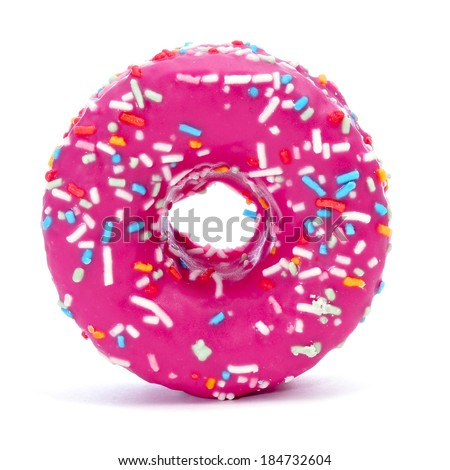 a donut coated with a pink frosting and sprinkles of different colors on a white background - stock photo