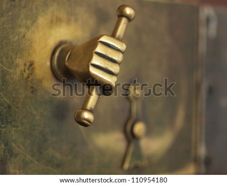 A door handle shaped as a human fist - stock photo