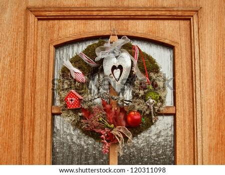 A door with Christmas wreath - stock photo