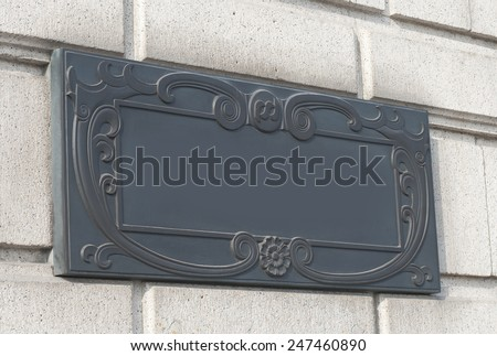 a doorplate on the wall in vintage style. - stock photo