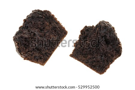 A double chocolate muffin that has been broken in half isolated on a white background.