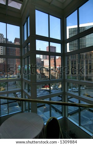 a downtown cafe scene in a modern building, downtown pittsburgh in the background. - stock photo