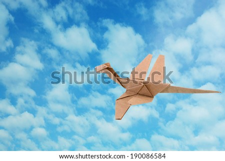 A dragonfly against blue sky