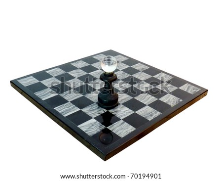 a dramatic black and white stone chess board with one piece left standing isolated on white with a clipping path