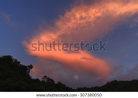 A dramatic clouds during sunset. - stock photo