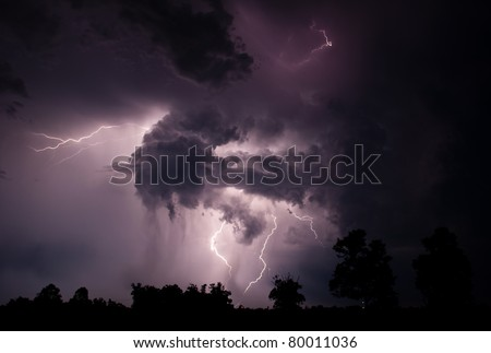 A dramatic scene is formed by a combination of intra cloud and cloud to cloud lightning. The pictures were shot around 3am on June 24, 2011 near West Point, AR - stock photo