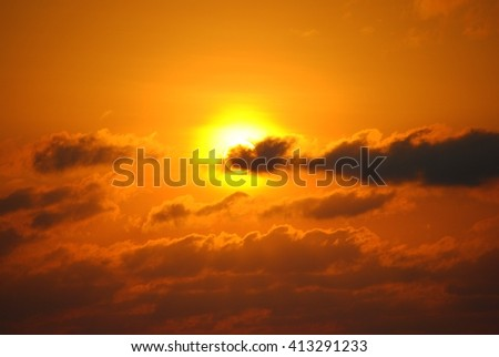 A dramatic sunset behind clouds