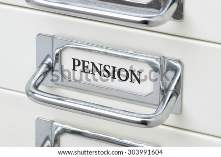A drawer cabinet with the label Pension - stock photo
