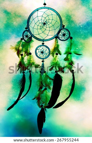 a dreamcatcher on bright background - stock photo