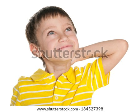 A dreaming little boy against the white background - stock photo