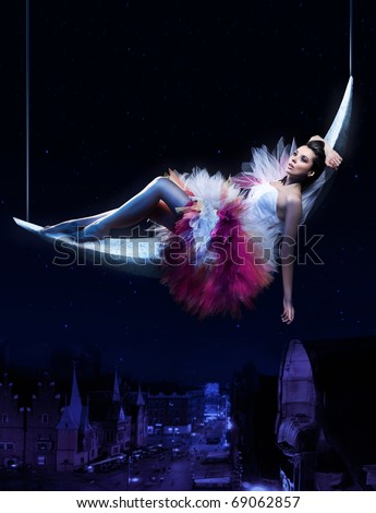 A dreamy image of a stunning beauty lying on the moon - stock photo