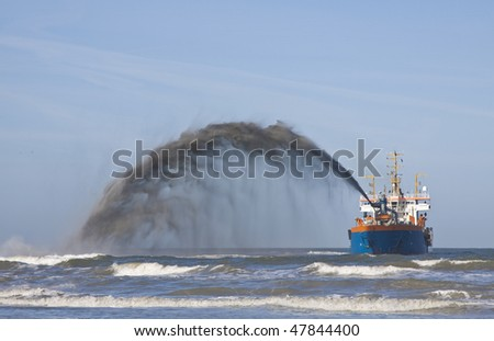 a dredger Rain bowing - stock photo