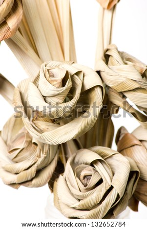 A dried Rose flower made from Pandan on a white background - stock photo