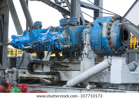 A drilling machine in a gas field. Close-up of the mechanism and parts of the platform.