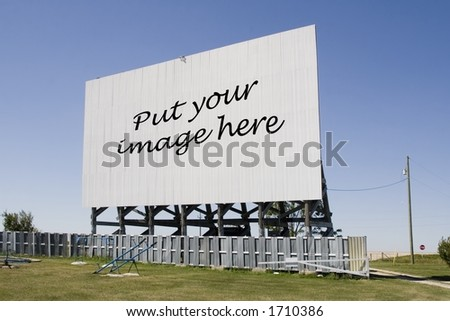 A drive-in movie screen at an angle with words. - stock photo