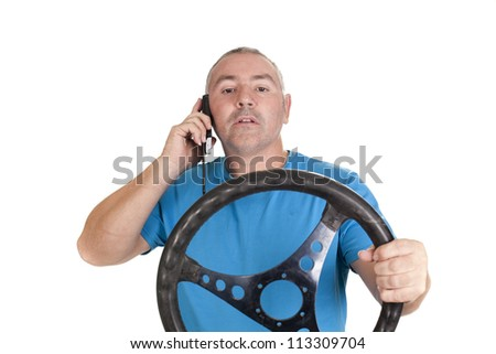 a driver talking on the phone, and prohibited dangerous situation - stock photo