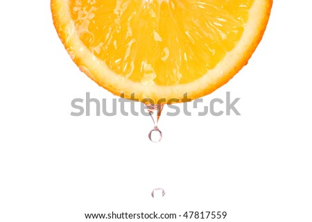 a drop of water on fresh orange
