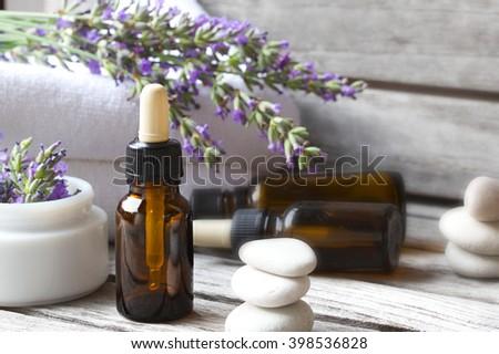 A dropper bottle of lavender essential oil. Closeup - stock photo