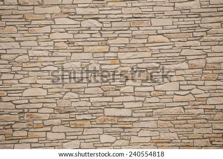 A dry stone wall made of random grey stone  - stock photo