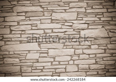 A dry stone wall made of random grey stone. wall of stones as a texture  - stock photo