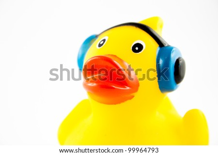 A duck is listening to music with headphones