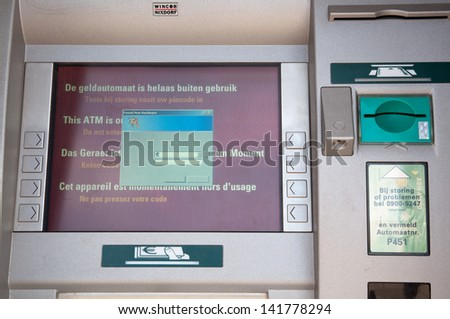 A Dutch ATM of the ABN-AMRO bank is out of order - stock photo