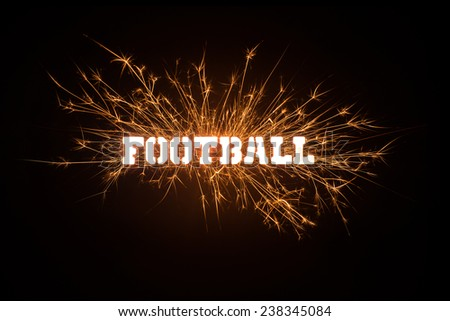 A dynamic headline of Football in sparks and fire on black background. - stock photo