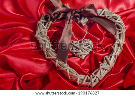 a elegant heart on a red fabric