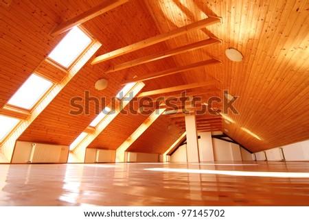 A empty attic apartment. - stock photo