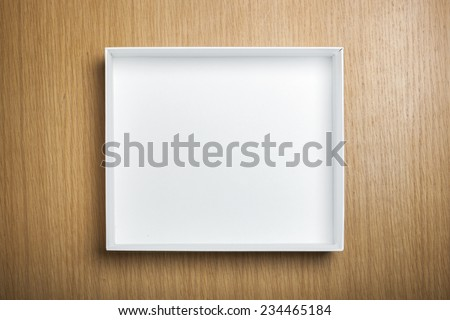 A empty(blank) white box on the desk(table) top view at the studio. - stock photo