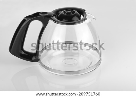a empty coffee pot on a glossy white table