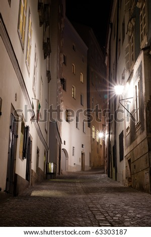 A European city street at night in portrait - stock photo