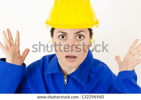 A expressive woman wearing protective equipment - stock photo