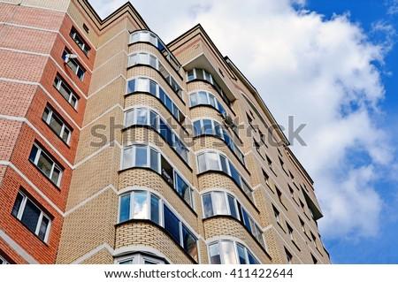 A Facade of a modern apartment building - stock photo