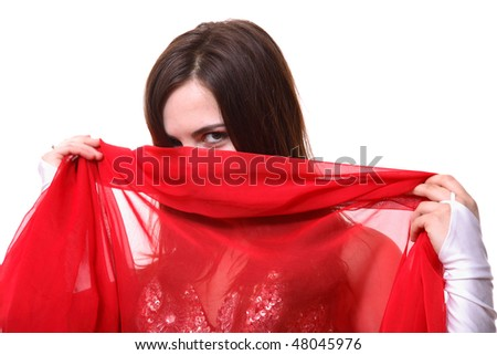 A face of an eastern girl in a red scarf - stock photo