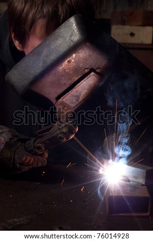 A factory welder at work - stock photo