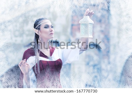 a fairy elf princess with snow ice on winter with lantern in her hand
