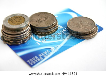 A fake creditcard with coin - stock photo
