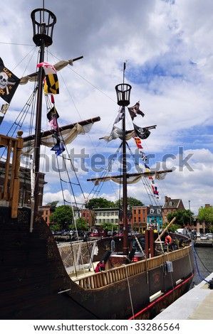 A fake pirate ship offers rides on Chesapeake Bay, Inner Harbor, Baltimore, MD - stock photo