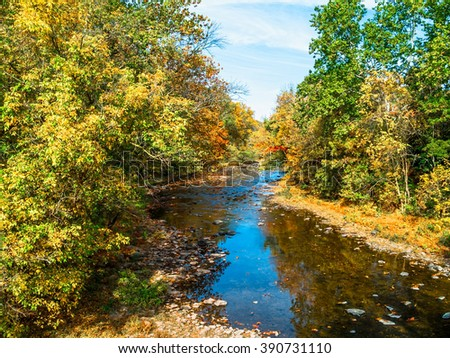 A fall view of Tohickon Creek in Pt Pleasant, Bucks County pennsylvania. - stock photo