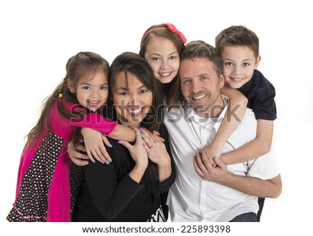 a fam'ly of five / express positivity / and hug each other - stock photo