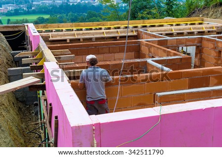 a family house is built in massive construction with brick. thermal insulation is fitted. - stock photo