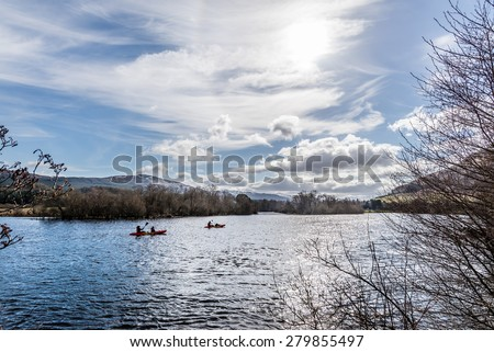 A family kayaking on Loch Tay, Scotland in springtime,
