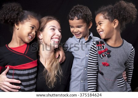 A family over dark background - stock photo