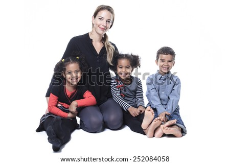 A family sitting on the floor of a photography studio - stock photo