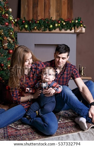 A family with a small child in the new year