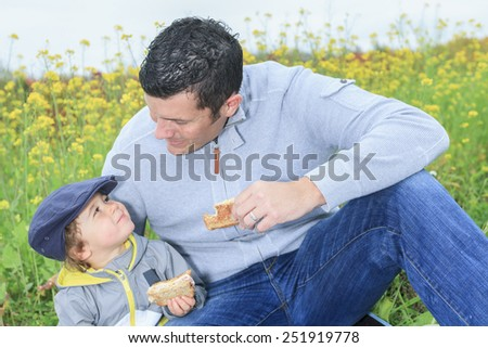 A Family with children having picnic in autumn season - stock photo
