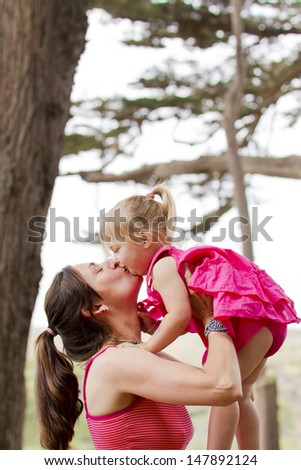 A family with young children enjoys the outdoors together. - stock photo