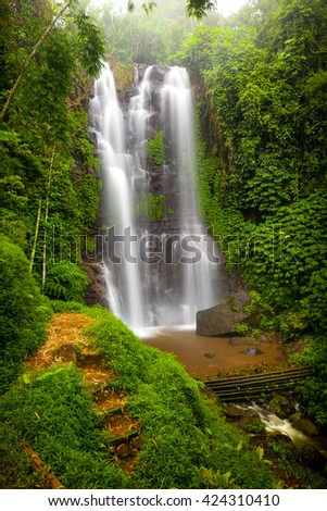 A famous Munduk Waterfall in a tropical jungle island of Bali, Indonesia