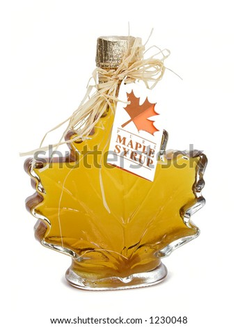 A fancy bottle of farm-made maple syrup. - stock photo